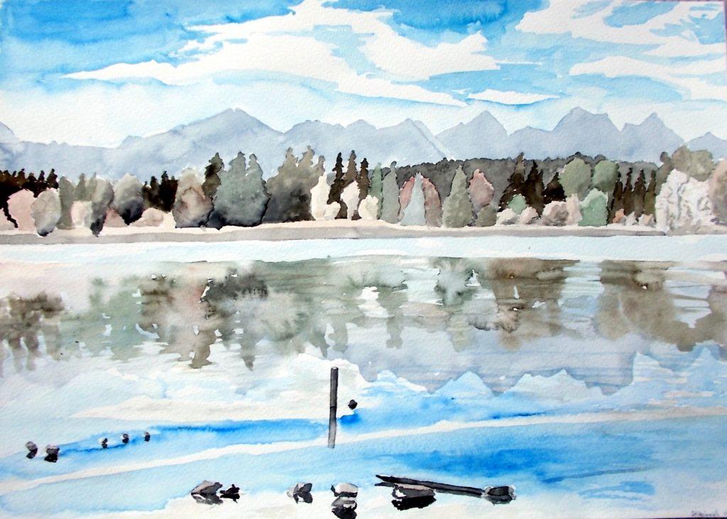 Der See spiegelt Herbst